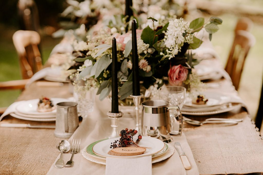 English orchard wedding inspiration with black taper candles