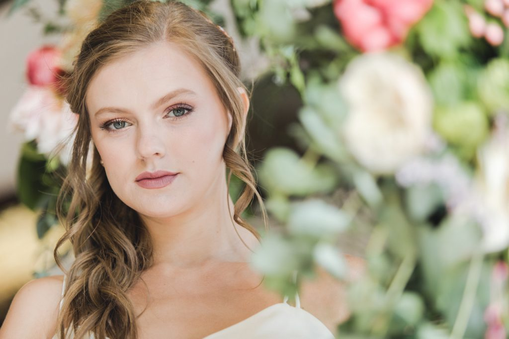 half up half down bridal hairstyle with neutral makeup
