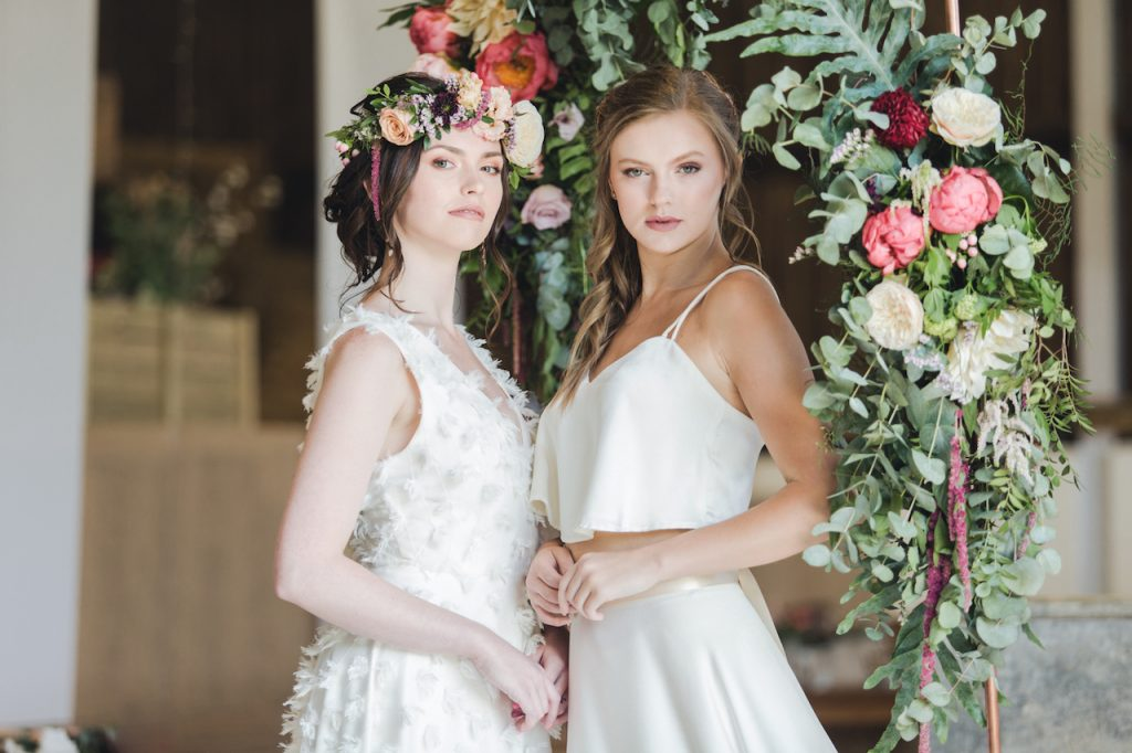 two brides bohemian hairstyles and neutral makeup