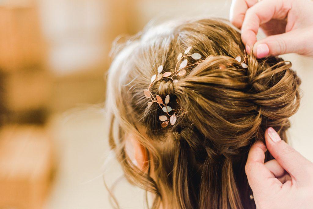 bridal half up half down braid detail with hair vine