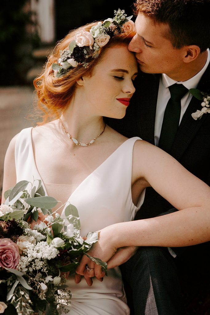 bride with updo flower crown and bold lip