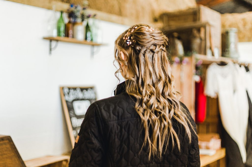 bridal half up half down hairstyle with intricate braided detail