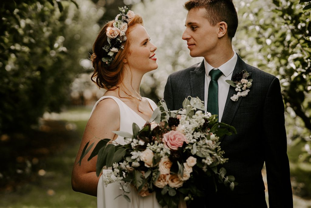 soft bridal updo with flower crown and loose tendrils
