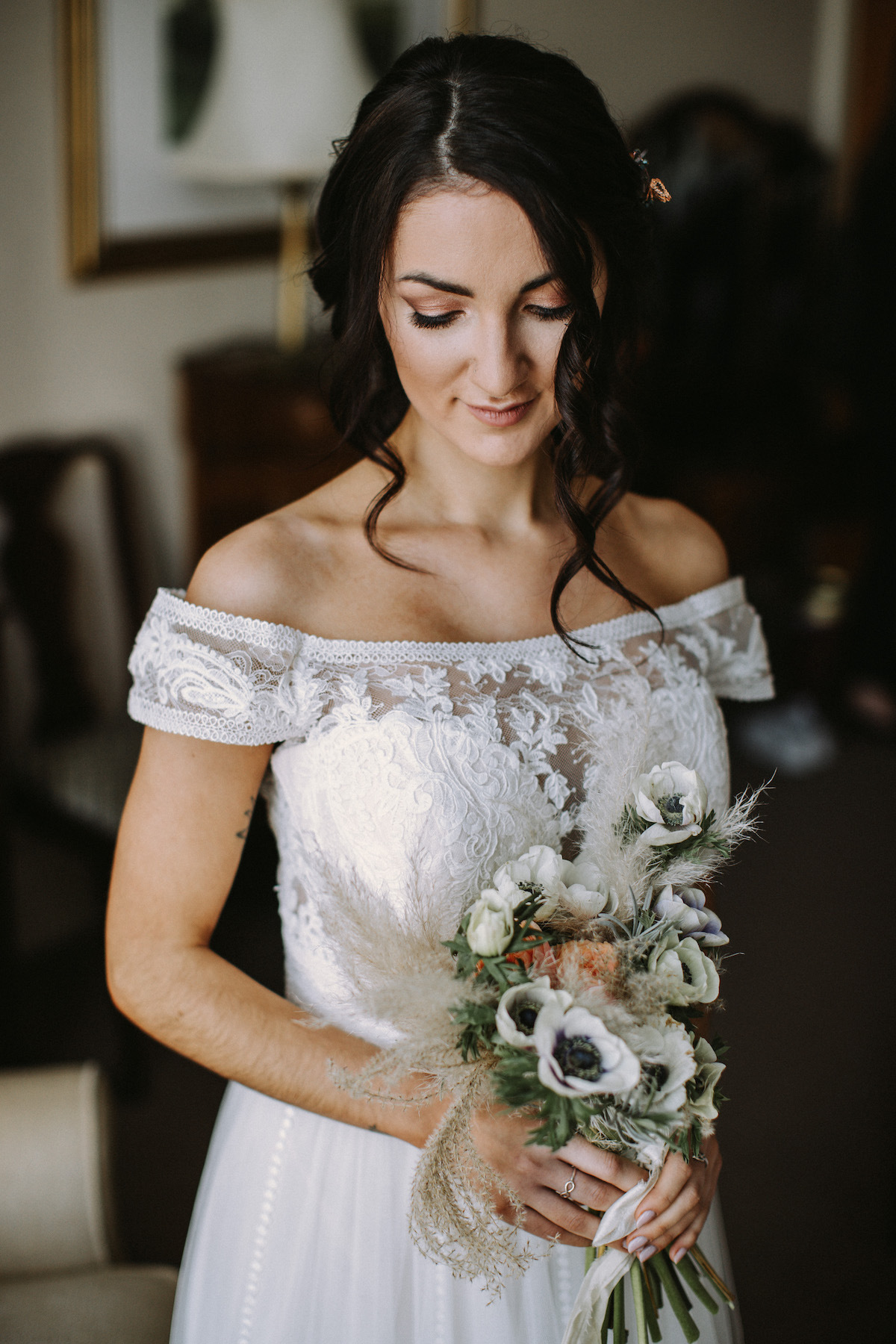 Boho bridal hair and makeup with handtied bouquet