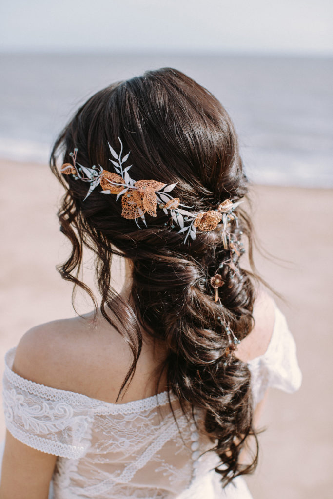 Loose braid bridal hairstyle with Ritz & Sass headpiece